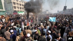 People protest in Peshawar, Pakistan, against the lack of transport, January 2, 2012