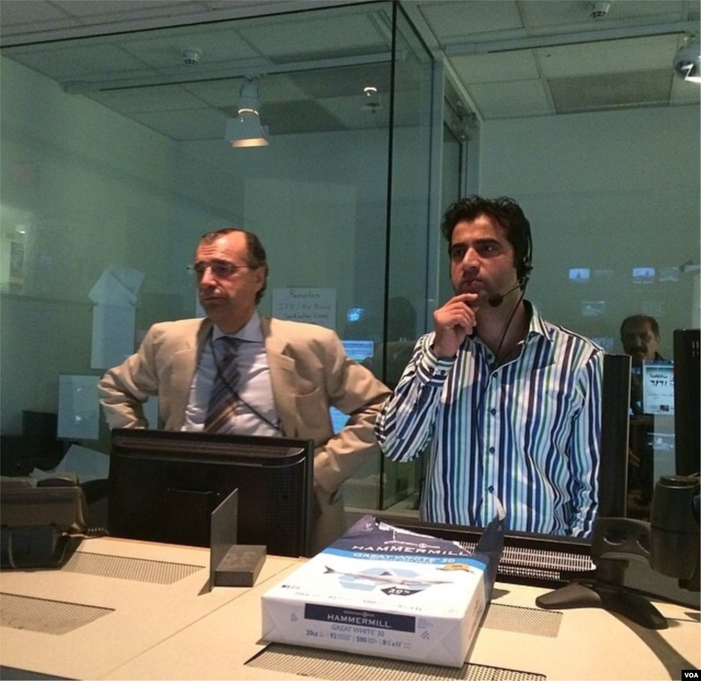 TV Ashna's Managing Editor Ahad Azizzada and Line Producer Abdullah Orokzai in Control Room 51 during a live show.