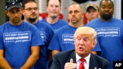 FILE - Then-Republican presidential candidate Donald Trump speaks during a campaign stop in Dayton, Ohio, Sept. 21, 2016. In the wake of Trump's victory, Democrats are looking at how to attract more working-class voters.