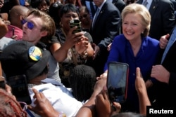 U.S. Democratic presidential nominee Hillary Clinton greets voters outside of an early voting site in Lauderhill, Florida, November 2, 2016.