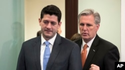 FILE - House Speaker Paul Ryan, R-Wis., left, and Majority Leader Kevin McCarthy, R-California, confer as they arrive to meet with reporters following a GOP strategy session at the Capitol in Washington, Feb. 6, 2018.