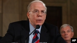 FILE - Acting CIA Director John McLaughlin appears before the Senate Armed Services Committee on Capitol Hill in Washington, Aug. 17, 2004, to discuss proposed reorganization of the intelligence community.