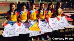 The Tibet Women's Soccer team signs autographs on jerseys, in Berlin, Germany, for the Discover Football event, June 30, 2015. (Facebook photo)