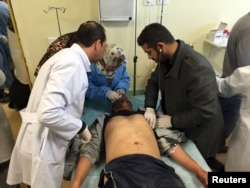 An injured man receives treatment inside a hospital in Misurata, Libya, on Jan. 7, 2016, after one of Libya's worst truck bombs in years exploded at a police training center in the town of Zliten.