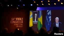 FIFA President Sepp Blatter is seen in a big screen as he delivers a speech during the opening ceremony of the 65th FIFA Congress in Sao Paulo, June 11, 2014.