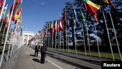 FILE - Television journalist reports in Flags Alley outside the United Nations, Geneva.