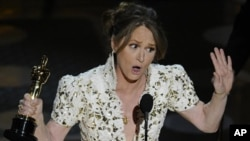 """Melissa Leo accepts the Oscar for best actress in a supporting role for """"The Fighter"""" at the 83rd Academy Awards on Sunday, Feb. 27, 2011, in the Hollywood section of Los Angeles."""