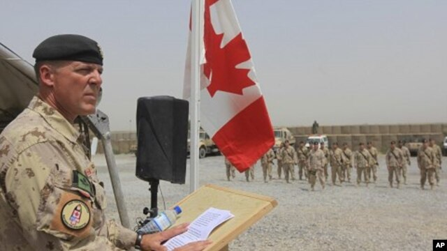 Brig.-Gen Dean Milner, Commander of Canadian forces in Afghanistan, speaks during a ceremony marking the Canadian handover of forward fire base Masum Ghar to US forces in Panjwaii district in Kandahar province, southern Afghanistan, July 5, 2011