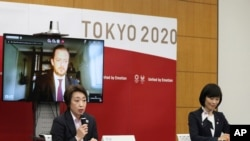 Officials of the Tokyo Olympics, Seiko Hashimoto, front left, Andrew Parsons, back left and Tamayo Marukawa at a meeting in Tokyo, March 11, 2021. Olympics Minister Marukawa said the vaccines have not been approved for use in Japan.