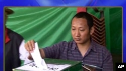 Election Review and Nepal ballot boxes