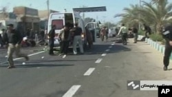 An ambulance attends the scene of a bomb blast in this image taken from TV, in Chahbahar, Iran, 15 Dec 2010