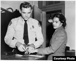 "Mrs. Rosa Parks (being fingerprinted), Negro seamstress, whose refusal to move to the back of a bus touched off the bus boycott in Montgomery, Alabama."" 1956. New York World-Telegram & Sun Collection, Prints and Photographs Division, Library of Congress."