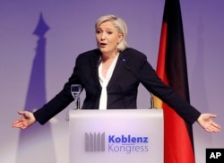 FILE - Far-right leader and candidate for next spring presidential elections Marine le Pen from France delivers a speech in Koblenz, Germany, Jan. 21, 2017.