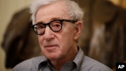 """FILE - In this Tuesday, July 2, 2019 file photo, director Woody Allen attends a press conference at La Scala opera house, in Milan, Italy. The filmmaker had sued Amazon after the online giant ended his contract without ever releasing a completed film, """"A Rainy Day in New York."""""""