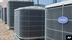FILE - Air conditioners of the Carrier brand, a United Technologies company, are installed in Omaha, Nebraska.