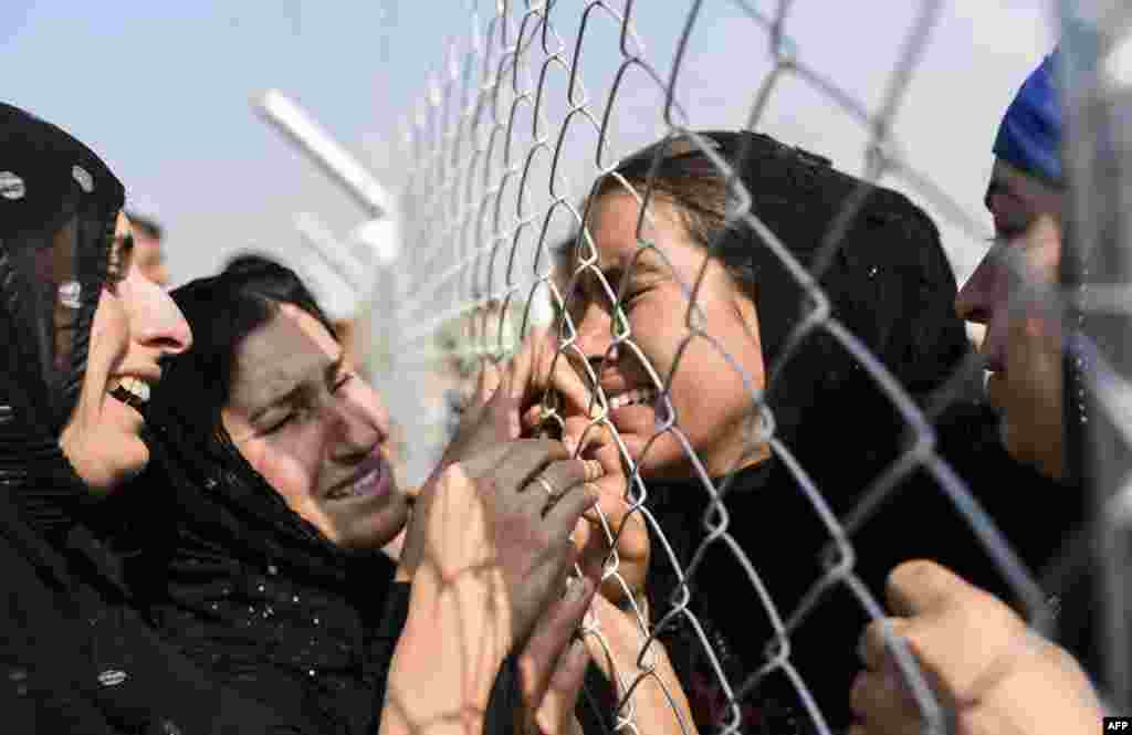 Newly displaced Iraqi's who fled from the city of Mosul, Iraq's last major Islamic State (IS) group stronghold, are reunited with their relatives who came two years ago to the refugee camp in the Khazer area, near the Kurdish checkpoint of Aksi Kalak some 40 kilometers east of Irbil.