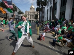 In this March 17, 2015 file photo Lamar Lester III dances while marching with the Doherty Clan during the 191st St. Patrick's Day parade in Savannah, Ga