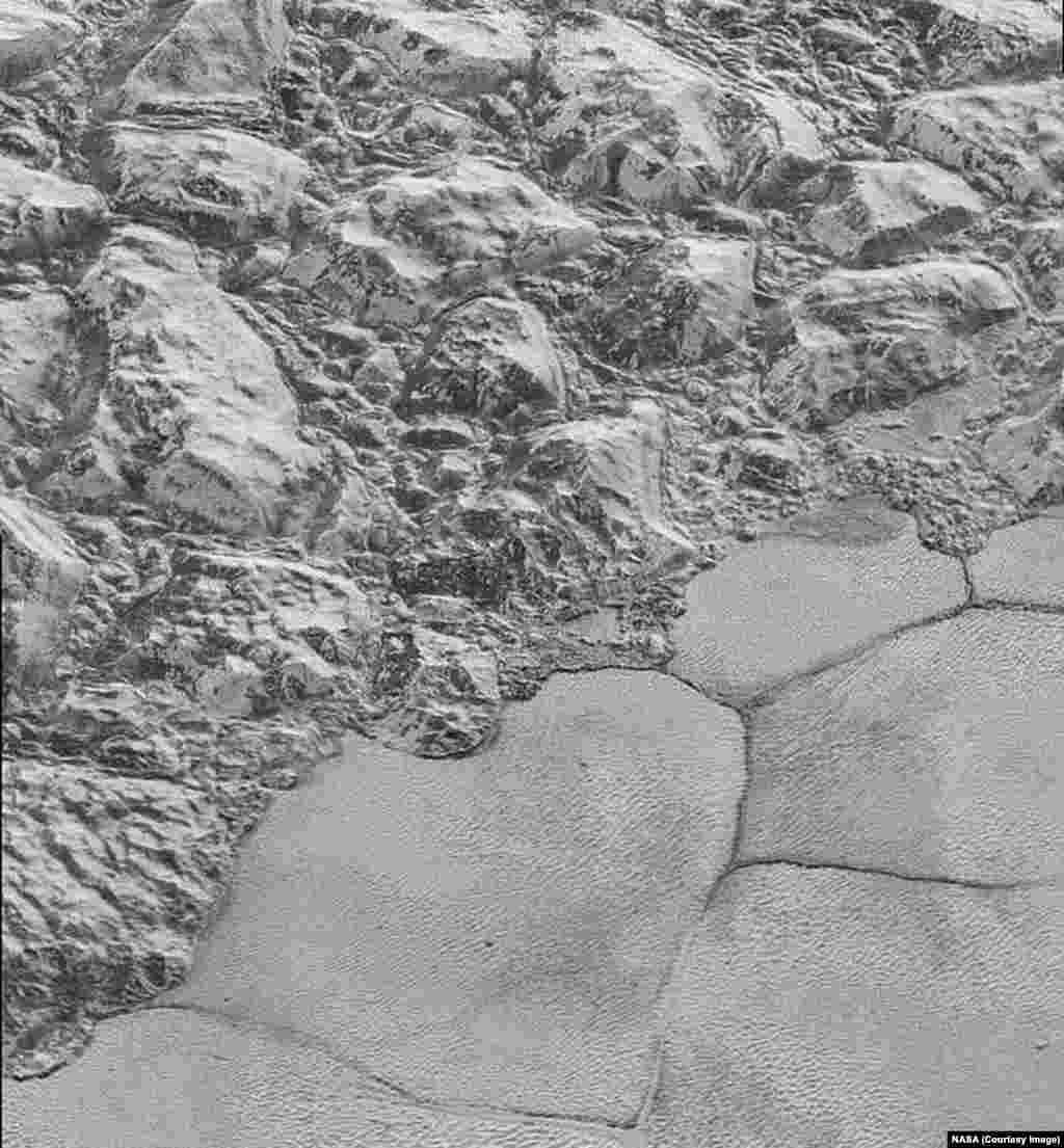 In this highest-resolution image from NASA's New Horizons spacecraft, great blocks of Pluto's water-ice crust appear jammed together in the informally named al-Idrisi mountains, released Dec. 4, 2015..