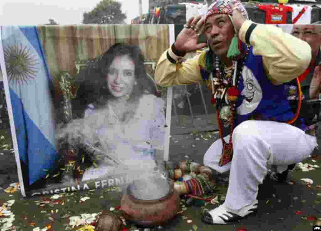 A shaman performs a ritual for good luck in 2012 as he prays in front of an image of Argentina's President Cristina Fernandez in Lima, Peru, Thursday Dec. 29, 2011. Fernandez was diagnosed with treatable thyroid cancer on Tuesday, and will undergo surgery