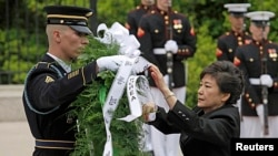 South Korean President Park Geun-hye lays a wreath at the Tomb of the Unknown Soldier at Arlington National Cemetery, May 6, 2013.