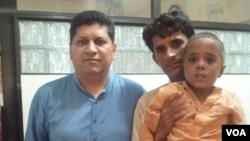 Hussain and his father, Haneef pictured with Dr. Asim Qidwai