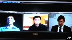 Oleg Kozlovsky, Issac Mao, Ernesto Hernandez Busto use the Skype technology to participate in the recent conference on the Internet and dissidents