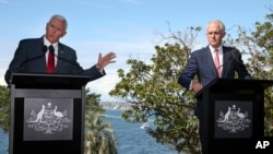 U.S. Vice President Mike Pence (left) speaks during a joint press conference with Australian Prime Minister Malcolm Turnbull in Sydney, April 22, 2017. Pence and Turnbull are joining forces in urging China to do more to pressure North Korea to drop its nu