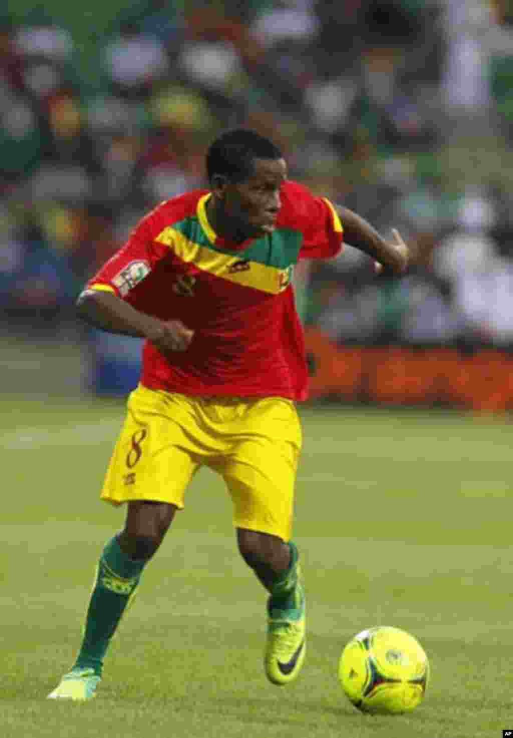 Guinea's Ibrahim Traore runs with the ball during their African Nations Cup Group D soccer match against Botswana at Franceville Stadium January 28, 2012.