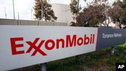 FILE - The sign for the Exxon Mobil Torrance Refinery in Torrance, Calif., Jan. 30, 2012. An explosion and fire at an oil refinery in Torrance, California, on Saturday forced the partial shutdown of the plant, leading oil traders to expect a spike this we