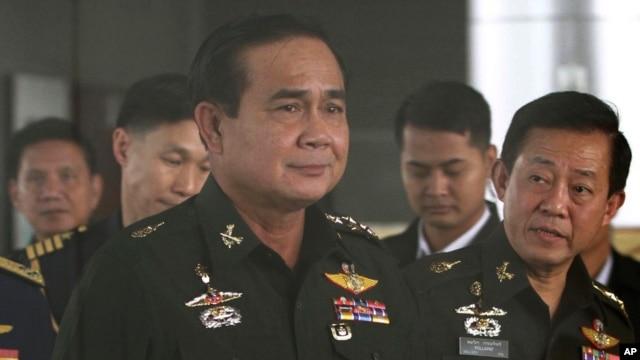 FILE - Thailand's Army commander Gen. Prayuth Chan-Ocha, left, arrives at the Royal Thai Army Club in Bangkok, Thailand.