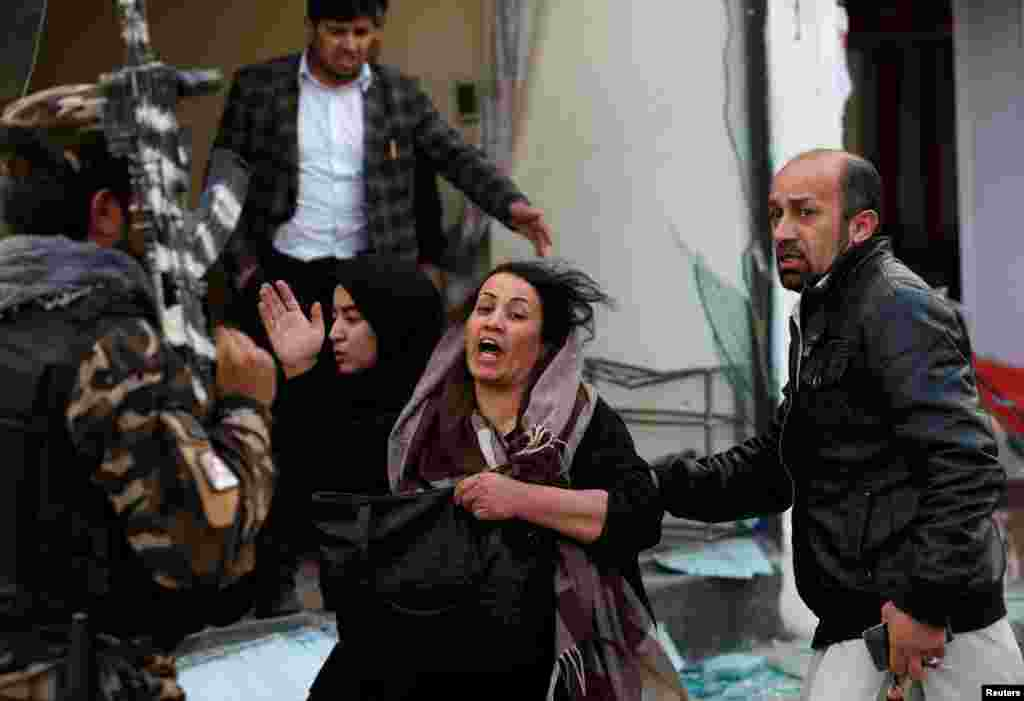 A survivor reacts at the site of a blast in Kabul, Afghanistan.
