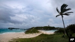 Wind and surf picks up as Hurricane Nicole approaches the Cooper's Island Nature Reserve in St. Georges, Bermuda, Oct. 12, 2016.