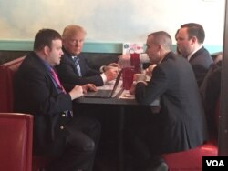 Donald Trump eats breakfast at the Airport Diner in Manchester, NH on the morning of the primary, Feb. 6, 2016. (Photo: K. Gypson/VOA)