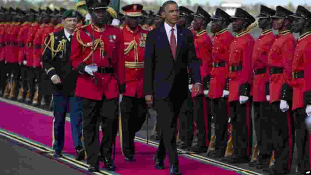 President Obama inspects the troops during an arrival ceremony in Dar Es Salaam, Tanzania.