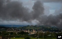 Black smoke from continuing military air strikes rises above a mosque in Marawi city, southern Philippines, June 9, 2017.