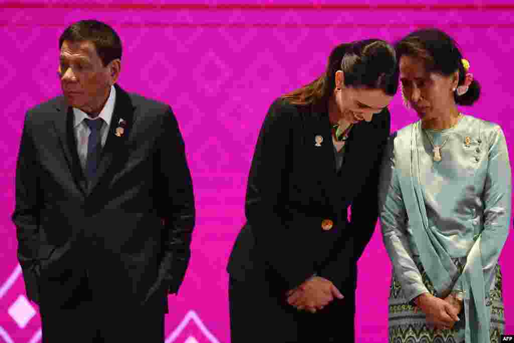 Myanmar's State Counsellor Aung San Suu Kyi (R) talks to New Zealand's Prime Minister Jacinda Ardern next to Philippines' President Rodrigo Duterte (L) during the 14th East Asia Summit in Bangkok, Thailand.