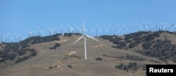 FILE - GE 1.6-100 wind turbines at a wind farm in Tehachapi, California, June 19, 2013.