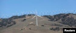 FILE - GE 1.6-100 wind turbines at a wind farm in Tehachapi, California, June 19, 2013.