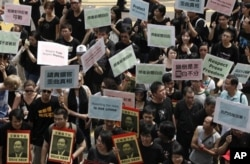 FILE - Hundreds of Hong Kong journalists, lawmakers and residents march to China's liaison office in Hong Kong, Sept. 13, 2009.