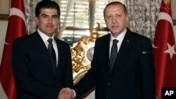 FILE - Turkey's President Recep Tayyip Erdogan, right, and Prime Minister of Iraq's autonomous Kurdish region Nechirvan Barzani shake hands before a meeting in Istanbul, Nov. 23, 2016.