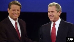 Democratic candidate Al Gore, left, and Republican candidate George W. Bush shake hands before the first presidential debate in 2000