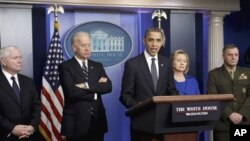 President Barack Obama delivers a statement in the White House Dec. 16, 2010, on the the Afghanistan-Pakistan Annual Review. From left are, Defense Secretary Robert Gates, Vice President Joe Biden, the president, Secretary of State Hillary Rodham Clinton,