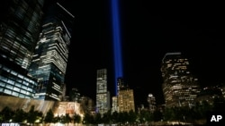 FILE - The Tribute in Light is seen in the sky above the National September 11 Memorial at the World Trade Center site on the 16th anniversary of the Sept. 11 terror attacks, New York, Sept. 11, 2017.