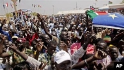 Southern Sudanese celebrate the announcement of preliminary referendum results in the southern capital of Juba, January 30, 2011.