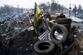 Barricades built at the site of recent clashes with riot police are seen in Kyiv, Ukraine, Feb. 13, 2014.