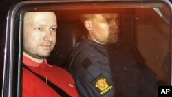 Norwegian Anders Behring Breivik (L), the man accused of a killing spree and bomb attack in Norway, sits in the rear of a vehicle as he is transported in a police convoy as he is leaving the courthouse in Oslo (File Photo - July 25, 2011)