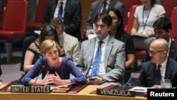 FILE - U.S. Ambassador to the United Nations, Samantha Power, addresses a resolution to investigate the use of chemical weapons in Syria during a United Nations Security Council meeting at the U.N. headquarters in New York, Aug. 7, 2015. On Friday, the U.N. Security Council received a report finding Syrian forces responsible for a third chemical weapons attack.
