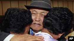 FILE - South Korean Lee Pung-no, center, weeps as he hugs with his North Korean daughters during the Separated Family Reunion Meeting at Diamond Mountain in North Korea.