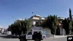 A Yemeni police vehicle patrols outside of the Iranian ambassador's residence in Sana'a, Yemen, Saturday, Jan. 18, 2014.