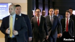 U.S. Treasury Secretary Steven Mnuchin (C) and the U.S. delegation for trade talks with China, leave a hotel in Beijing, China May 3, 2018. Talks between U.S. and Chinese officials have not yet restarted.